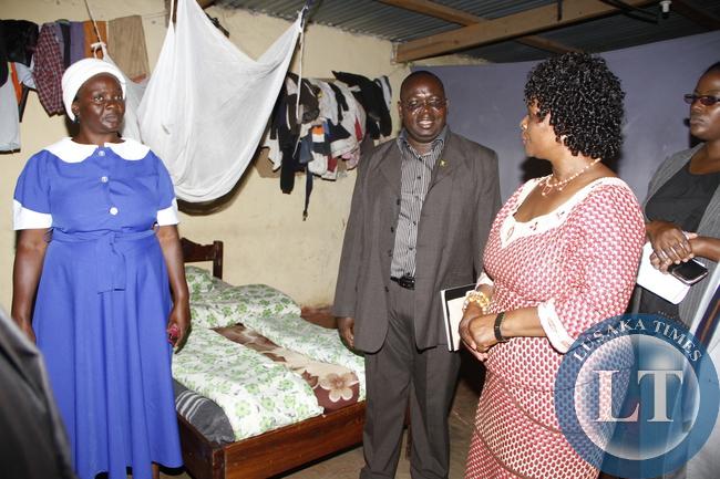First Lady Esther Lungu tours  Mansa SDA Orphanage as the orphanage Coordinator  Webby Kalipenta  looks on in Luapula Province