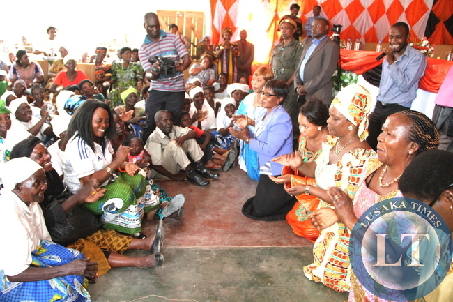 First Lady Esther Lungu  joined by ministers spouses show appreciation to  the electorates for voting  for President Edgar Chagwa Lungu in the January 20,2015 elections. This was at Mpulungu District Council's hall and then at the market where she addressed Ngwenya Marketeers Women Group in Northern Province of Zambia on March 3,2015 -Picture by THOMAS NSAMA