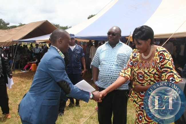 Lands Minister Ngimbu is being welcomed by a Youth represeatitve  during Youth Day celebratons in Solwezi.