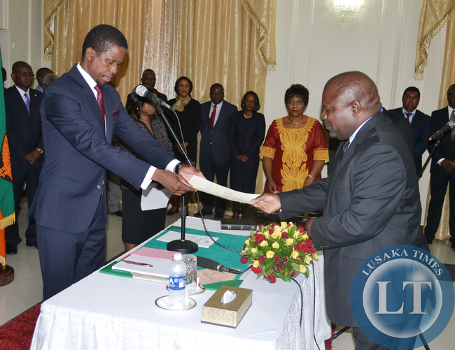 President Edgar Lungu swears in Lucky Mulusa as Special Assistant for Project Monitoring and Implementation at State House in Lusaka on 3 March 2015