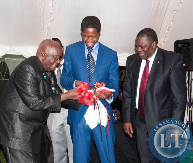 Dr Kenneth Kaunda and President Edgar Lungu admire the reprint of Dr Kaunda's book Zambia Shall Be Free, looking on is Kagem chairman William B Nyirenda