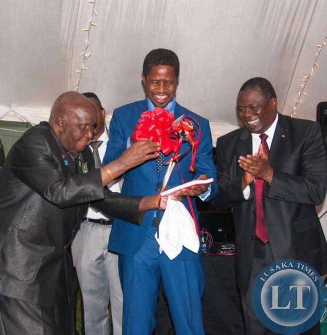 Dr Kenneth Kaunda and President Edgar Lungu admire the reprint of Dr Kaunda's book Zambia Shall Be Free, presented by Kagem chairman William B Nyirenda
