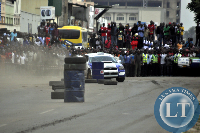Spectators cheering one rally driver
