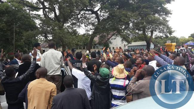 UPND supporters  throng UPND president Hakainde Hichilema at Woodland Police station.