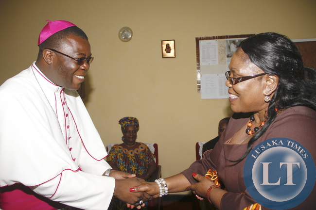 Former First Lady Vera Chiluba  greets  Diocese of Mansa Bishop Patrick Chisanga when First Lady Esther Lungu paid a courtesy call on him at his offices in Luapula Province  on February 28,2015. This was during First Lady's Outreach Programme for People with Special Needs -Picture by THOMAS NSAMA