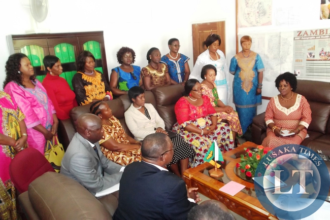 Luapula Province Minister Brigadier General Benson Kapaya briefing the first Lady on some developmental Projects in the province when she paid a courtesy call on him at his Office in Mansa. With her is the former First lady Vera Chiluba, ministers wives and friends of the first lady from Kafue PF Constituency. Looking on is Luapula Province Permanent Secretary Bornface Chimbwali.