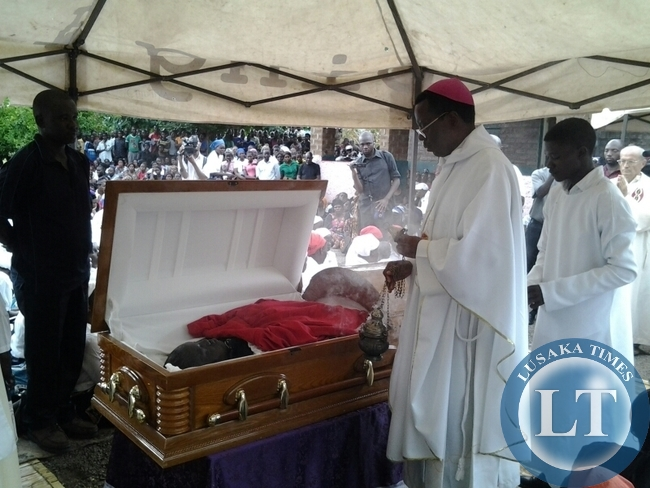 Chipata Diocese Catholic Bishop George Lungu blessing the casket of late Chief Jumbe IV,Robert Zulu in Mambwe District .The chief was buried at a royal graveyard.