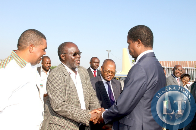 President Edgar Lungu Transport, Communication, Works and Supply deputy minister Mutaba Mwali  (c) and Lusaka Province minister Mwaliteta (l)  at Harare International Airport  shortly before departure  for Bulawayo where he will officially open the Zimbabwe Trade Fair on April 30,2015 -Picture by THOMAS NSAMA