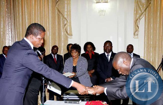 Newly appointed Foreign Affairs Permanent Secretary Chalwe Lombe being congratulated by President Lungu during the Swearing in Ceremony at State House on April 8,2015 -Picture by THOMAS NSAMA-STATE HOUSE