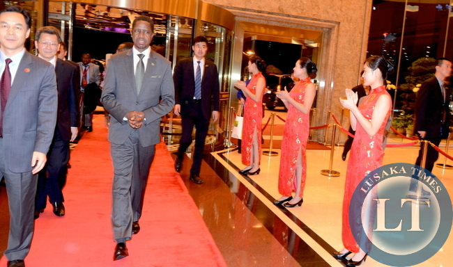President Edgar Lungu being welcomed by Shenzhen Deputy Mayor Chen Biao upon arrival at Wuzhou State Guest House in Shenzhen, China on continued State Visit on March 31,2015 -Picture by THOMAS NSAMA