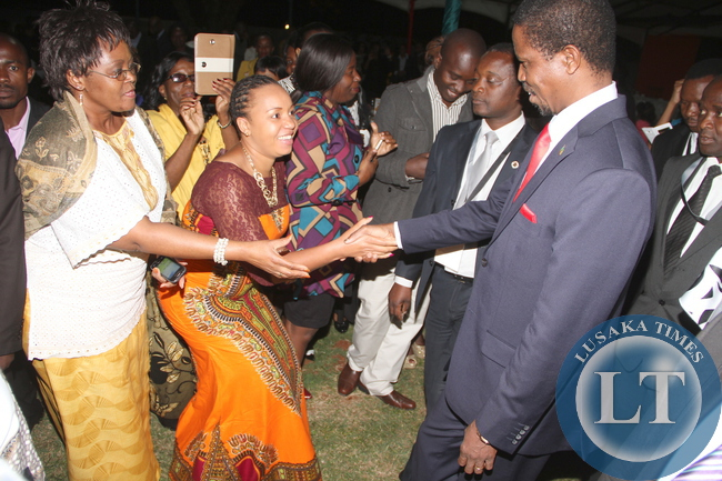 President Edgar Lungu greets Zambian's living in Zimbabwe after he addressed them at the Zambia's Ambassador to Zimbabwe's resident in Harare on April 29,2015 -Picture by THOMAS NSAMA