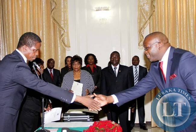 President Edgar Lungu congratulates Newly appointed Attorney Likando Kalaluka during the Swearing in ceremony at State House on April 8,2015 -Picture by THOMAS NSAMA