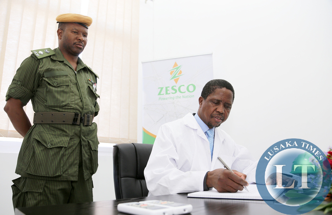 President Lungu Signs a Visitors Book at ZESCO Lunzua Power Plant