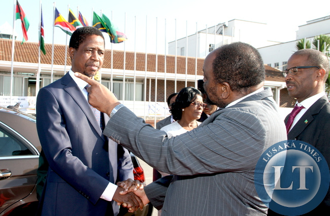 President Edgar Chagwa Lungu with Zimbabwe's Foreign affairs minister  Simbarashe Mumbengegwi at Harare International Airport shortly before  departure for Bulawayo where he will officially open the Zimbabwe Trade Fair on April 30,2015 -Picture by THOMAS NSAMA
