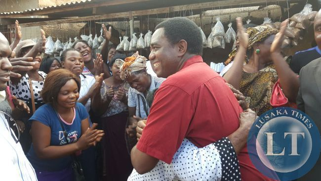 UPND president Hakainde Hichilema interacts with residents in Bauleni compound