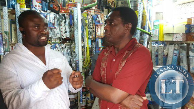UPND president Hakainde Hichilema talks to business owner  in  Bauleni compound