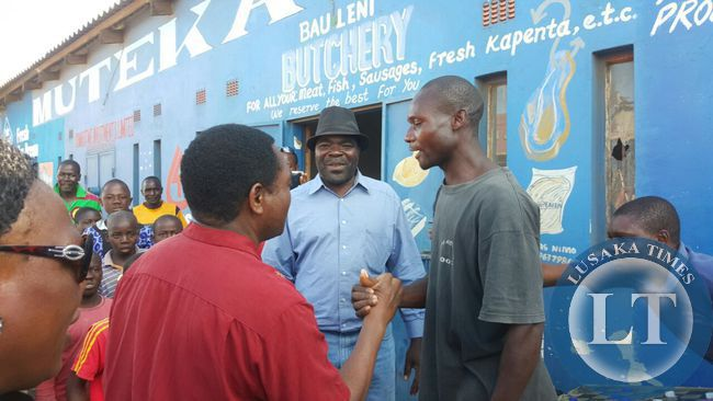 UPND president Hakainde Hichilema interacts with small busniess owners in  Bauleni compound