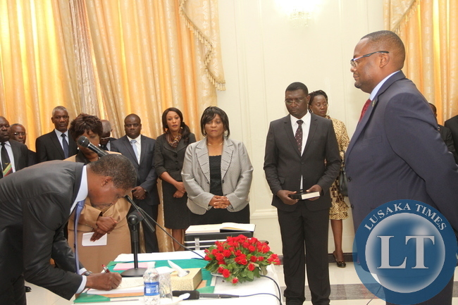 President Edgar Lungu receives an affidavit of Oath from Zambia's High Commissioner to South Africa Emmanuel Mwamba during the swearing -In-Ceremony at State House on May 4,2015 -Picture by THOMAS NSAMA