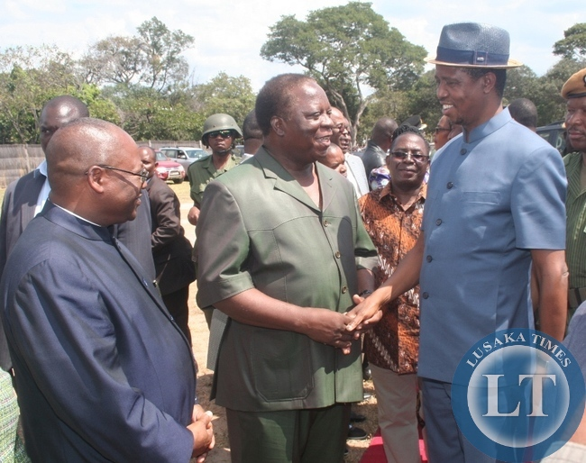 President  Edgar Lungu  being welcomed by former republican vice-president Enock Kavindele at Kalene airstrip mission airstrip in Ikeleng'e