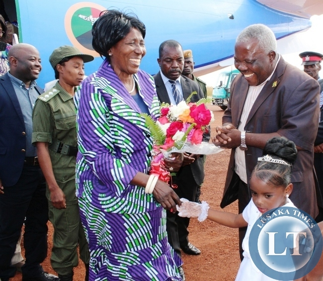 Vice president Inonge Wina being welcomed by Nkusechela Sinkamba upon arrival at Kasama airport today. Looking on is Northern Province Minister Freedom Sikazwe.The Vice President is on a four day tour of developmental projects in the Province