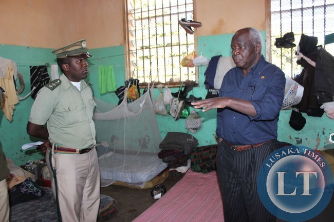 Home Affairs Deputy Minister Panji Kaunda (right) talks to Livingstone Central Prison assistant superintendent and deputy office in charge Ivor Musumali (left) inside Livingstone Central Prison on
