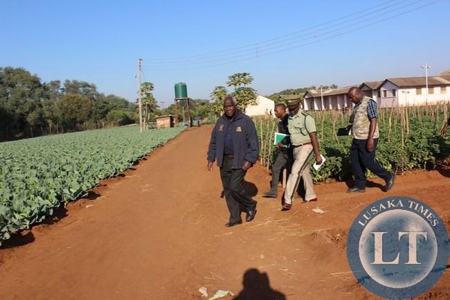 Home Affairs Deputy Minister Panji Kaunda (left) leading a delegation in inspecting vegetables at Livingstone Central Prison on Monday