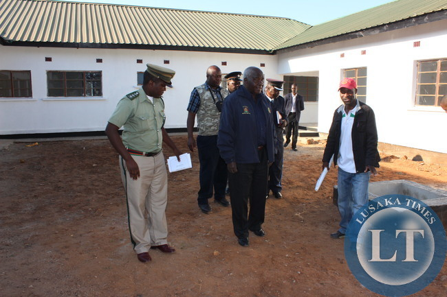 Home Affairs Deputy Minister Panji Kaunda inspecting one of the police houses at Livingstone Police Camp