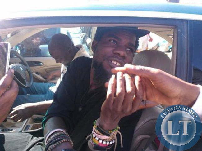 Pilato being whisked away after court adjourned