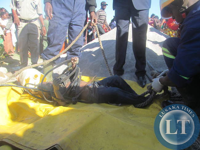 The body of Ben Muleba retrieved from the well by KCM rescue team.v