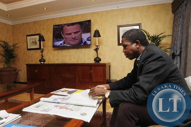His Excellency Mr. Edgar Chagwa Lungu President of the Republic of Zambia reads the Pretoria Newspaper at Sheraton Hotel on Monday, June 22,2015. PICTURE BY SALIM HENRY/STATE HOUSE © 2015