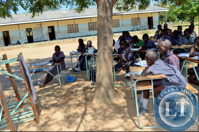 File:Children learning under a tree at Sialwala Primary School located in Sinazongwe,due to lack of classrooms.