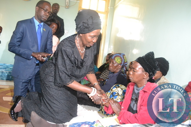 ACTING President Inonge Wina consoles the Mary Munthali, mother to Abel Munthali who is one of the deceased miners.