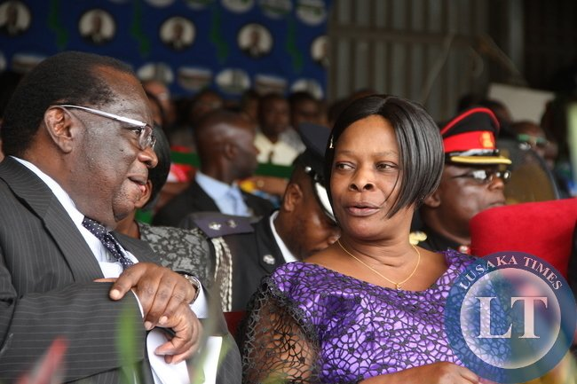 First Lady Esther Lungu speaks with Malawi's Finance minister Goodall Gondwe during Malawi's 51st Independence Celebrations at Kamuzu Stadium in Blantyre on July 6,2015 -Picture by THOMAS NSAMA