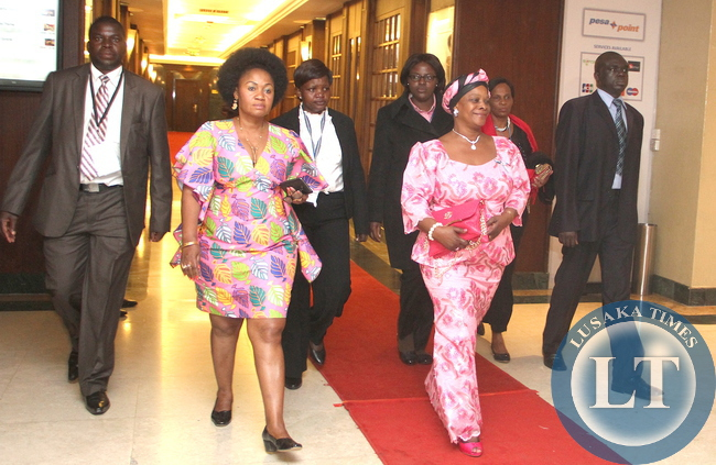 First Lady Esther Lungu flanked by  Kenya's Senator Emma Getrude  Mbura  on  leaves Inter Continental Hotel  for Dinner Hosted by Kenya's President Uhuru Kenyatta in honour of First Ladies attending  the 9th Stop Cervical, Breast and Prostate Cancer in Africa Conference in Nairobi on July 20,2015 -Picture by THOMAS NSAMA