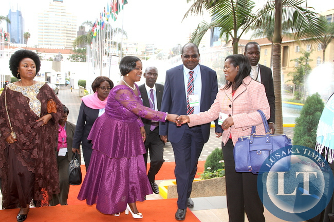 First Lady Esther Lungu greets Ministry of Health's Dr Sharon Kapambwe as Ministry of Health Deputy minister Dr Chitalu Chilufya looks on on   arrives   at Kenya International Convention Centre for the main Plenary Session of the 9th Stop  Cervical , Breasts and  Prostrate cancer in Africa Conference in Nairobi on July 21,2015 -Picture by THOMAS NSAMA