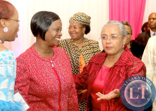 First Lady Esther Lungu with Kenya's First Lady Margaret Kenyatta during a welcome Cocktail hosted by James  Macharia, Cabinet Secretary for Health in honour of  Visiting First Ladies attending the 9th Stop Cervical, Breast and Prostrate Cancer in Africa Conference. This was at InterContinental  Hotel in Nairobi on July 19,2015 -Picture by THOMAS NSAMA