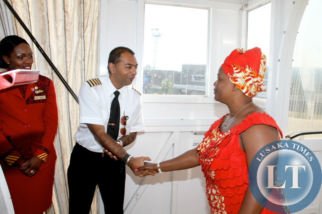 First Lady Esther Lungu being welcomed by Kenya Airways Pilot at Kenneth Kaunda International Airport  shortly before departure for Kenya  for  the 9th Stop Cervical, Breast and Prostate Cancer in Africa Conference in Nairobi on July 18,2015 -Picture by THOMAS NSAMA