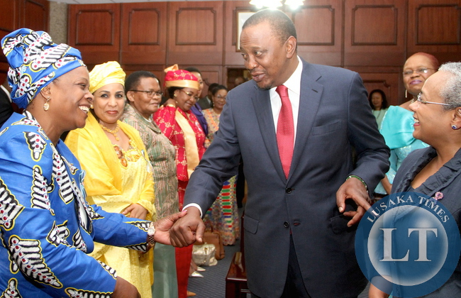 First Lady Esther Lungu with Kenya's President Uhuru Kenyatta  and  Kenya's First Lady Margaret Kenyatta shortly before the opening of the 9th Stop Cervical, Breast and Prostate Cancer in Africa Conference at Kenya International Convention Centre in Nairobi on July 20,2015 -Picture by THOMAS NSAMA