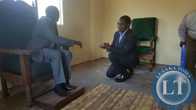 HH kneels to greet MwineLubemba