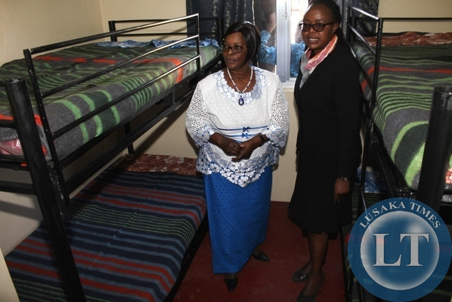 -First Lady Esther Lungu (l) with Lewanika General Hospital Superintendent Dr. Mapani Mutanga (r) inspects the beds in the new Lewanika General Hospital Relatives' Shelter constructed with the support of the Ministers' Wives Club in Mongu