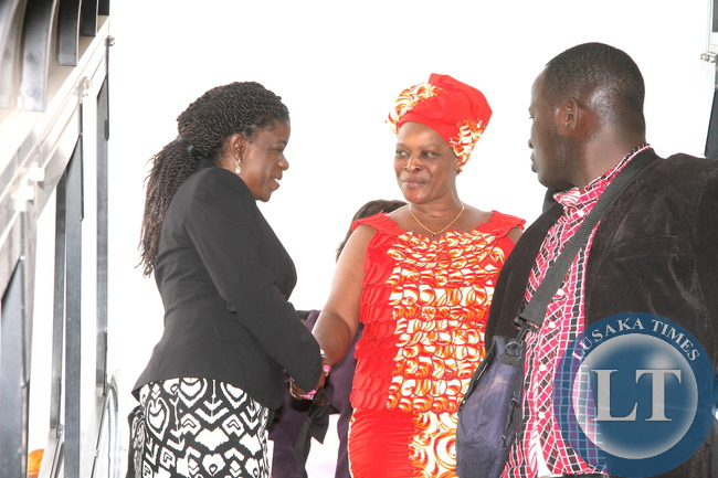 First Lady Esther Lungu being welcomed by Zambia's High Commissioner to Kenya Brenda Muntemba on arrival at Jomo Kenyatta International Airport  for  the 9th Stop Cervical, Breast and Prostate Cancer in Africa Conference in Nairobi on July 18,2015 -Picture by THOMAS NSAMA