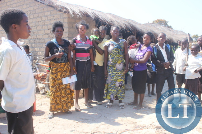 Some teenage mothers pose for a photo at Kaishe Community Health Center