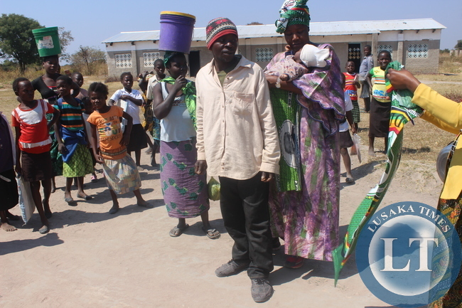 President Nawakwi gives a party chitenge to a father who had taken his child for under five at Kaishe.
