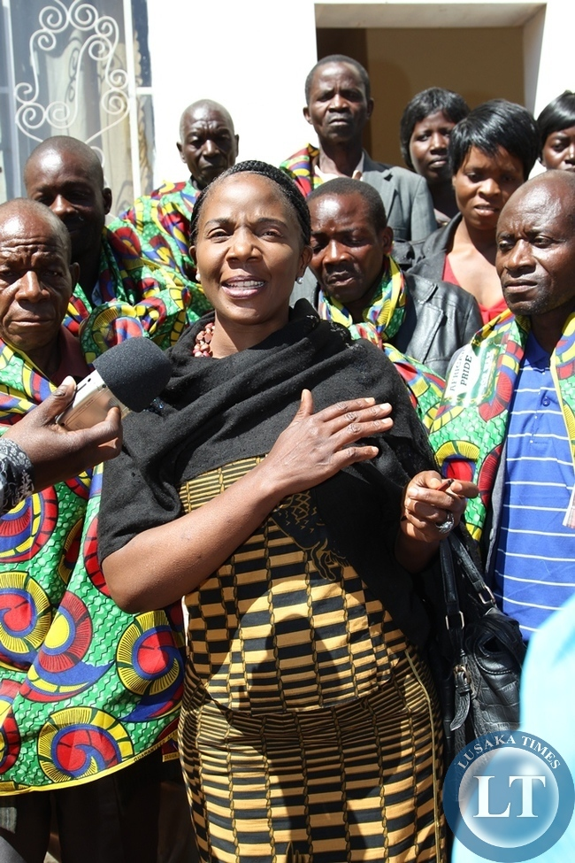Independent candidate Prudence Mwansa talks to her supporters after successfully filing in nominations for Bangweulu constituency in Samfya