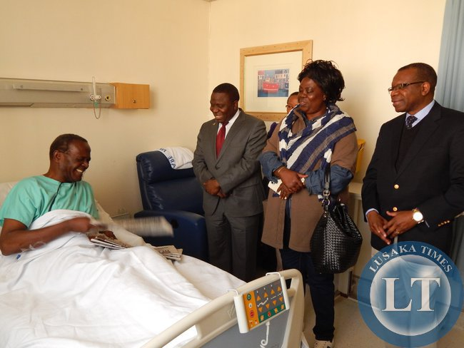 L-R - FOREIGN Affairs Minister, Mr. Harry Kalaba, Tourism and Arts Minister, Ms. Jean Kapata, and out-going Zambia's High Commissioner to South Africa, His Excellency Mr. Muyeba Chikonde during the visit to see Archbishop Mpundu at Milpark Hospital in Johannesburg on 22nd July, 2015