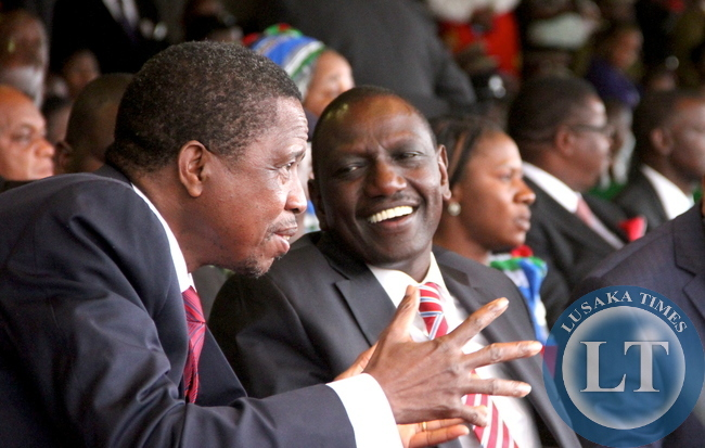 President Lungu talks to Kenya's deputy President William Ruto during Malawi's 51st Independence Celebrations at Kamuzu Stadium in Blantyre on July 6,2015 -Picture by THOMAS NSAMA