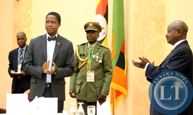 President Edgar Lungu with President Yoweri Museveni at a state dinner at Entebe Statehouse