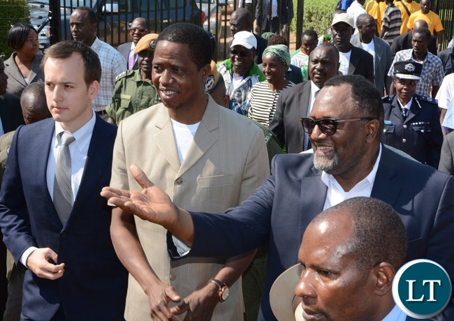 Director of Yalelo Zambian Fish Fisho Mwale welcomes President Edgar Lungu (c) Chairman of the board Adam Taylor (l) looks on during the Commissioning of the Yalelo Zambian Fish in Siavonga