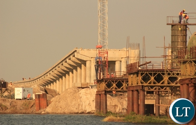 Construction works of the Mongu-Kalabo Road Project main bridge over the Zambezi River are underway and the total work progress has reached 80% and is scheduled to complete in April 2016.