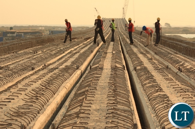 Works underway on top of the main bridge across the Zambezi River on the Mongu-Kalabo Road Project.